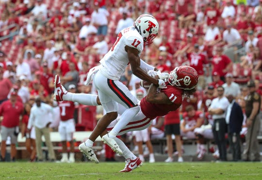 Sep 28, 2019; Norman, OK, USA;  Oklahoma Sooners wide receiver Jadon Haselwood (11) and Texas Tech Red Raiders defensive back John Davis Jr. (17) battle for the ball during the second half at Gaylord Family - Oklahoma Memorial Stadium. Mandatory Credit: Kevin Jairaj-USA TODAY Sports