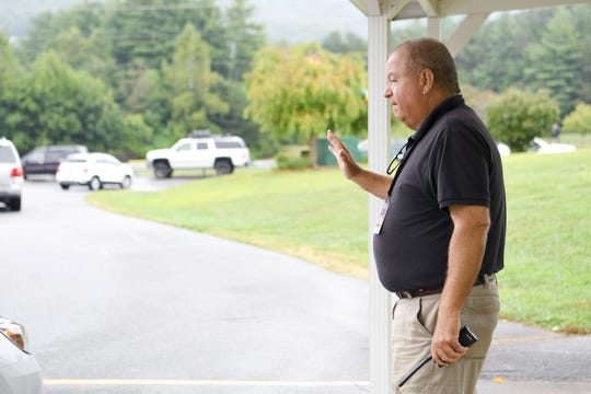 Mike Ruby helps with the car line outside of Reynolds Middle School as students are picked up at the end of the day on Aug. 27, 2019. After retiring this summer as the director of the School Resource Officers unit of the Buncombe County Sheriff's Office Ruby has stayed on at the school to assist in the in-school suspension room.