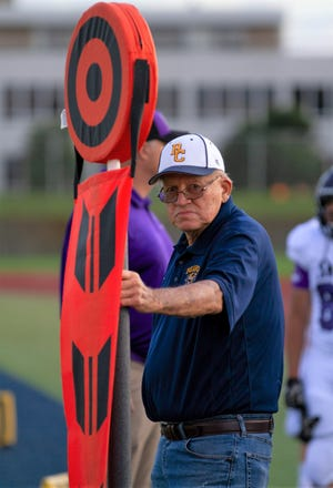 Ron Pluymers has been working on the chain gang for high school football games at Battle Creek Central for 35 years without missing a Friday night.