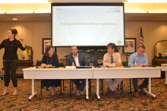 Rebecca Fleury, Joe Sobieralski, Ted Dearin and John Hart answer questions at Monday's Battle Creek City Commission economic development town hall.