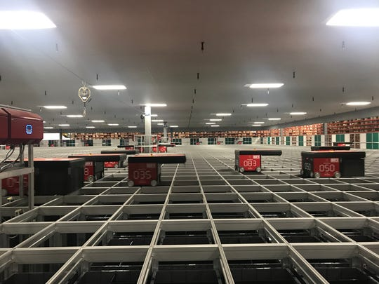 An AutoStore Machine at Dick's Sporting Good's new tech facility within the Conklin Distribution Center contains 97,000 totes for storing goods.