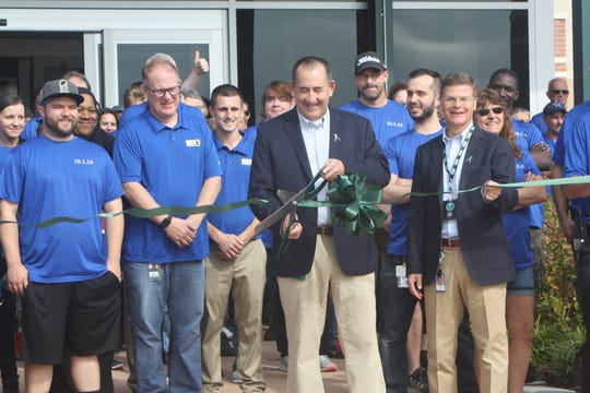 Andy Matt, the Facility Leader Dick's Sporting Goods' Conklin Distribution Center, cuts the ribbon on the new tech facility at the Conklin Distribution Center.