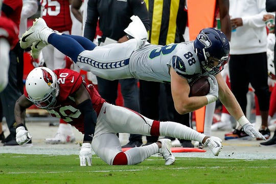 Seattle Seahawks tight end Will Dissly (88) is hit by Arizona Cardinals defensive back Tramaine Brock (20) Sunday, Sept. 29.