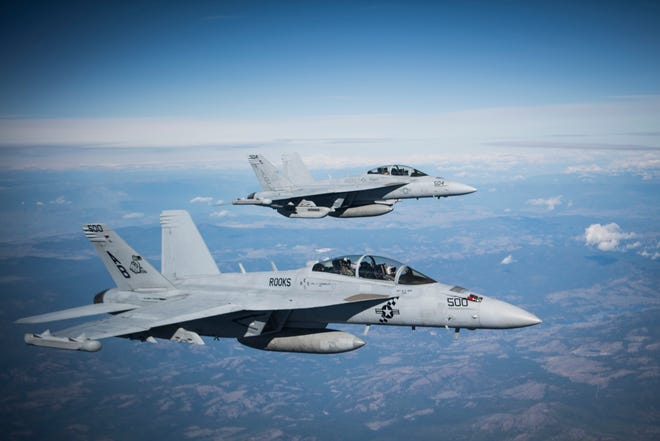 """The EA-18G Growlers from Naval Air Station Whidbey Island will pass over a memorial service in Driftwood Key for John """"Mike"""" Wolf at 2:15 p.m. Saturday at an altitude of 1,000 feet."""