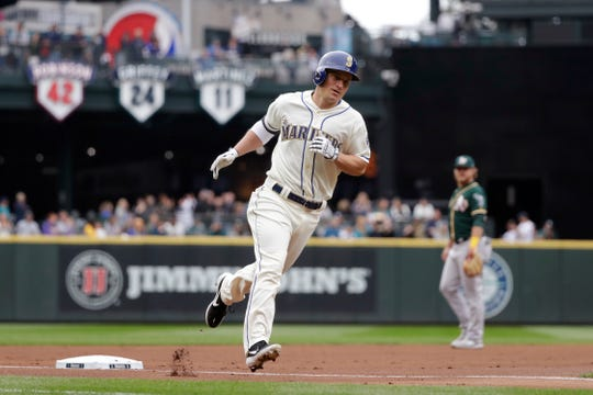 Seattle Mariners' Kyle Seager rounds the bases on his two-run home run against the Oakland Athletics in the first inning of a baseball game Sunday, Sept. 29, 2019, in Seattle.