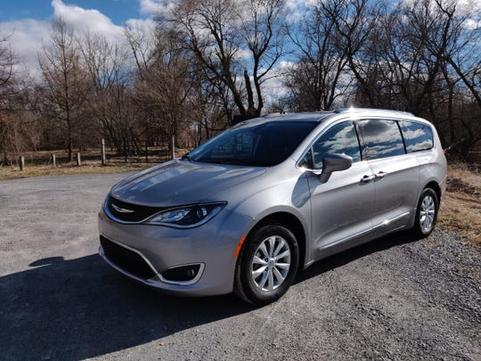 John Grimaldi's Chrysler Pacifica is retrofitted with the video game Rock Band, karaoke, and strobe lights
