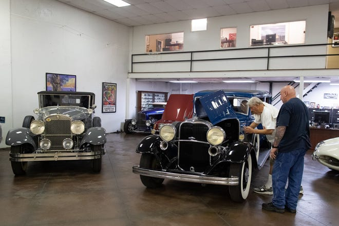 George Finley looks at a Lincoln, one of more than 200 cars up for auction Oct. 4-5 at American Bank Center.