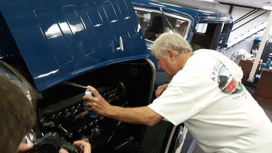 George Finley III puts the final touches on a 1932 Lincoln KB V-12 sedan ahead of the Corpus Christi Old Car Museum Auction. More than 200 vehicles are set to be auctioned off during the event Oct. 4-5, 2019.