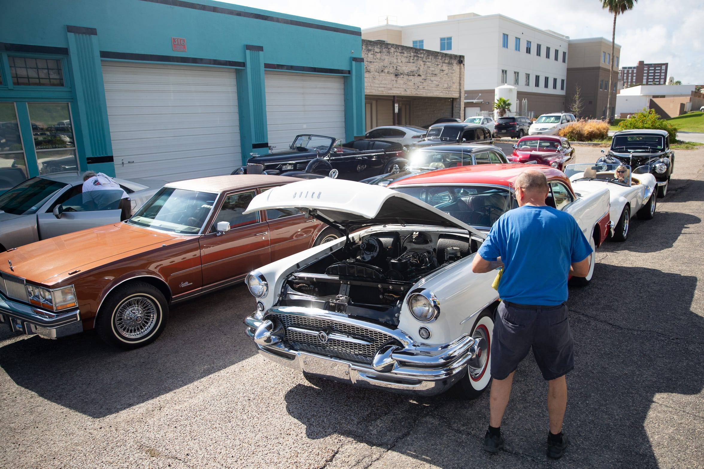 Cars are lined up as they are brought over to the American Bank Center for an auction of more than 200 cars.