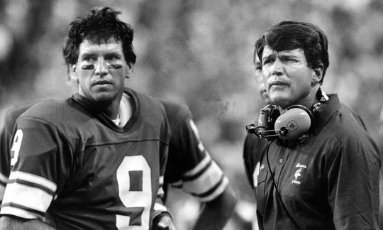 Minnesota Vikings head coach Les Steckel and quarterback Tommy Kramer watch during a game in 1984.