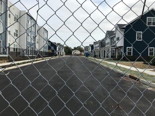 A chain-link fence keeps trespassers out of a construction zone at the new Branch Village homes in Camden's Centerville neighborhood.