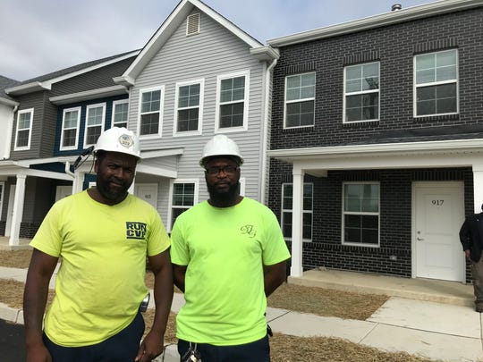 Kevin Rivera (left) and Moses Mumford are Centerville residents who've been hired to work on the redevelopment of Branch Village.