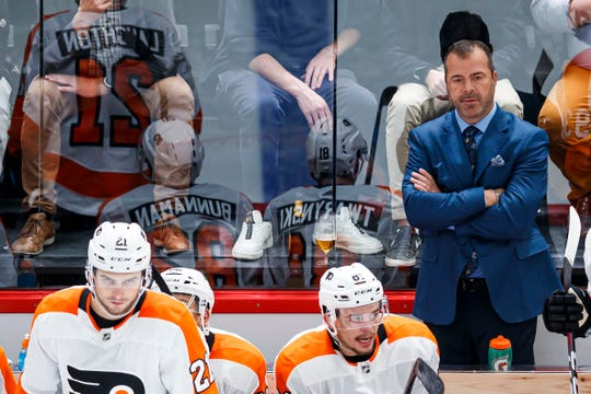 Friday afternoon the Flyers will open their season with Alain Vigneault behind the bench and the roster he coaches will be fluid for a while.