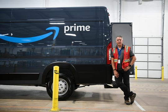 Jose Mercado poses with his Amazon truck in Bellmawr, N.J.