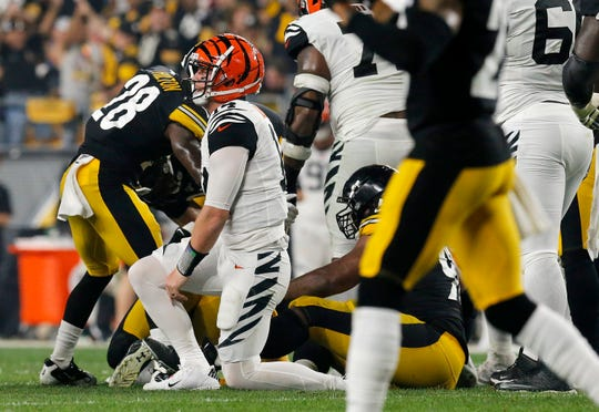 Cincinnati Bengals quarterback Andy Dalton (14) returns to his feet after giving up a sack-fumble in the second quarter of the NFL Week 4 game between the Pittsburgh Steelers and the Cincinnati Bengals at Heinz Field in Pittsburgh on Monday, Sept. 30, 2019.