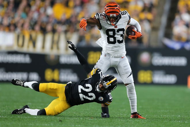 Cincinnati Bengals wide receiver Tyler Boyd (83) turns downfield after completing a catch as Pittsburgh Steelers cornerback Steven Nelson (22) defends in the second quarter of an NFL Week 4 game, Monday, Sept. 30, 2019, at Heinz Field in Pittsburgh. Pittsburgh Steelers lead 10-3 at halftime.