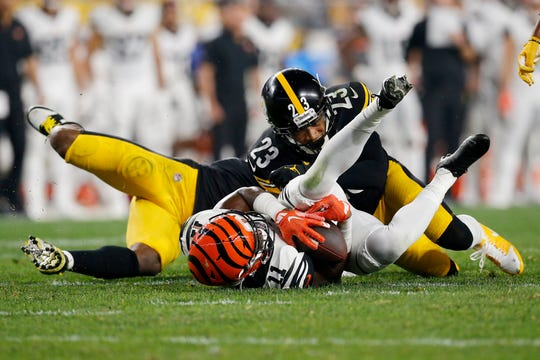 Cincinnati Bengals wide receiver John Ross (11) is brought down by Pittsburgh Steelers cornerback Joe Haden (23) on a reception in the fourth quarter of the NFL Week 4 game between the Pittsburgh Steelers and the Cincinnati Bengals at Heinz Field in Pittsburgh on Monday, Sept. 30, 2019. The Bengals fell to 0-4 on the season with a 27-3 loss in Pittsburgh on Monday Night Football.