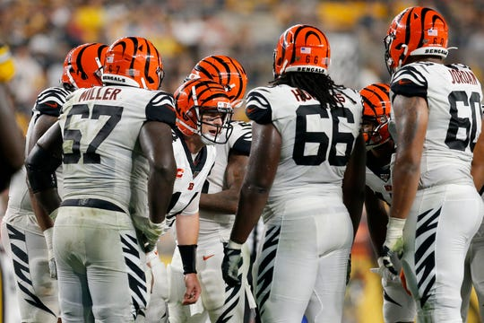 Cincinnati Bengals quarterback Andy Dalton (14) calls a play in the huddle during the fourth quarter of the NFL Week 4 game between the Pittsburgh Steelers and the Cincinnati Bengals at Heinz Field in Pittsburgh on Monday, Sept. 30, 2019. The Bengals fell to 0-4 on the season with a 27-3 loss in Pittsburgh on Monday Night Football.