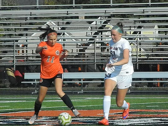 Somerville's Ashleigh Frankel (11) and Mount St. Mary's Margaret Burke both go for the ball during their game on Tuesday, Oct. 1, 2019.