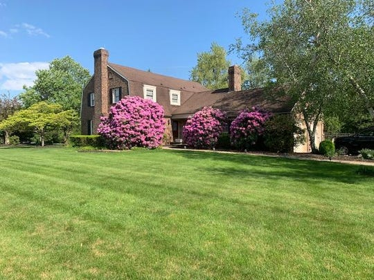 A custom built 2900-square-foot brick Colonial on about two acres of landscaped property is for sale for $669,900. An open house will be held on Sunday, Oct. 20.