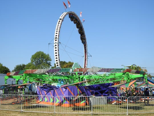 The Cliff Hangar and Fireball rides at the Coshocton County Fair.