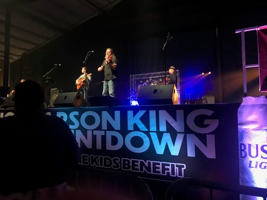 Royce Johns, an organizer of the Carson King Countdown, performs with his band during the event Monday in Des Moines.