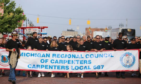 Michigan Regional Council of Carpenters Local 687 as they march in Detroit's annual Labor Day Parade along Michigan Avenue in Corktown in 2015.