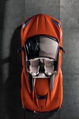 2020 Chevrolet Corvette Stingray convertible features twin nacelles behind the seats that recall the design of classic Corvette research vehicles and race cars of the 1950s and '60s.