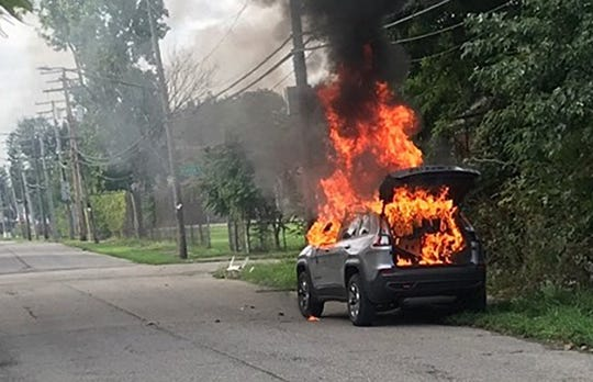 An SUV burns in Detroit after being stolen in Ferndale last month.