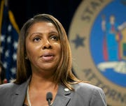 In this June 11, 2019 file photo, New York Attorney General Letitia James speaks during a news conference in New York. James has sued the NRA's former advertising agency to enforce a subpoena stemming from a probe of their nonprofit status.