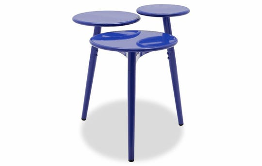 Bold blue: Drew Barrymore's Multi-Tier Metal Accent Table from her Flower Home collection has midcentury charm and adds a pop of color to any room in the house, $159, walmart.com. (Walmart/TNS)