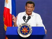 """In this Aug. 27, 2019, file photo, Philippine President Rodrigo Duterte addresses land reform in Manila, Philippines. Duterte left for Moscow on Tuesday, Oct. 1, 2019, to meet Vladimir Putin, whom he has described as his """"idol."""""""