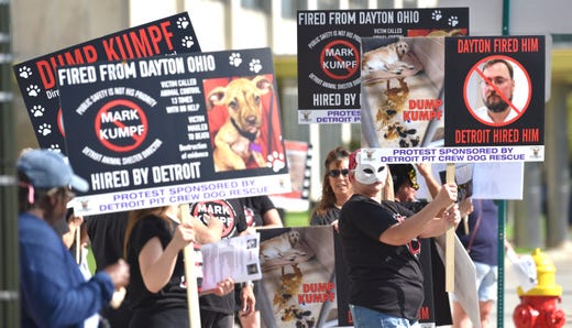 More than 28 animal-rights advocates protest the appointment of Mark Kumpf, director of Detroit's Animal Care and Control (DACC) division, in front of the Coleman A. Young Municipal Center, Tuesday morning.