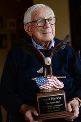 Michiganian of the Year, Mort Harris, 99, WWII veteran, industrialist, philanthropist. Harris is being honored because he is one of the last surviving pilots from D-Day in 1944. He shows off a plaque that was given to him by members of Turner Construction Co. who are also veterans, in honor of his service to the country.