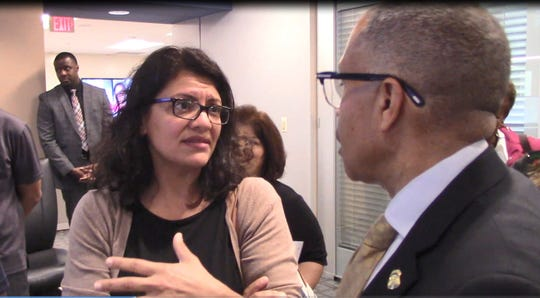 U.S. Rep. Rashida Tlaib and Detroit police chief James Craig discuss facial recognition technology during a tour of Detroit's Real Time Crime Center