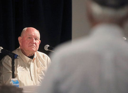 U.S. Secretary of Agriculture Sonny Perdue listens to a question from a Wisconsin farmer during a town hall meeting at the World Dairy Expo in Madison, Wis. Tuesday, Oct. 1, 2019.