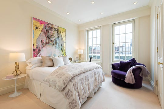 A purple side chair adds a powerful color pop to this bedroom. (Design Recipes/TNS)