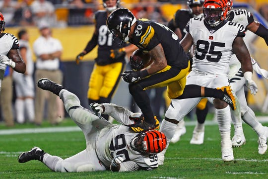 Pittsburgh Steelers running back James Conner (30) runs over Cincinnati Bengals defensive tackle Andrew Billings (99) during the second half.