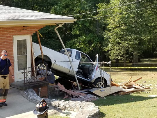 A truck crashed into a home on Kratzville Road Tuesday morning.