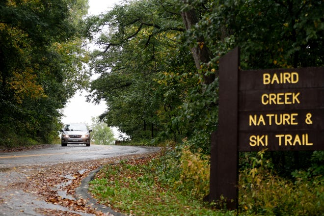 Cars drive in the rain on Tuesday, Oct. 1, 2019, near Baird Creek Nature and Ski Trail in Green Bay, Wis. Green Bay received 0.55 inch of rain as of 3 p.m. Oct. 1, breaking the record for the most precipitation in a year. That record was set in 2018.