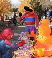 Families stroll through Menominee Park Zoo participating in the Zooloween Boo event in 2012.