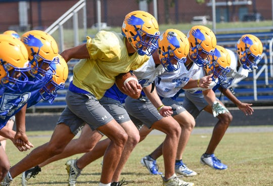 Wren senior Joe Owens(1), middle, runs with a ball with teammates during practice in Piedmont Tuesday.