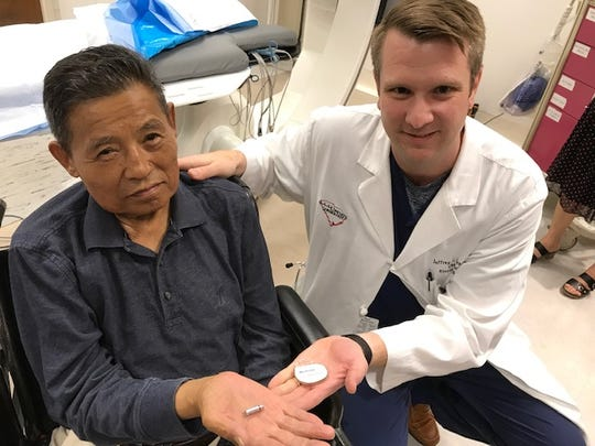 Lai Yang and Dr. Jeffrey Senfield compare the Micra pacemaker to a conventional one at Bon Secours St. Francis Health System