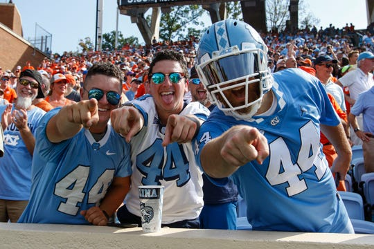 Sep 28, 2019; Chapel Hill, NC, USA; North Carolina Tar Heels fans celebrate after the North Carolina Tar Heels scored a touchdown against the Clemson Tigers in the first half at Kenan Memorial Stadium. Mandatory Credit: Nell Redmond-USA TODAY Sports