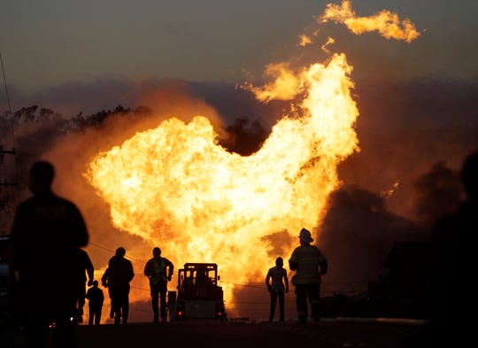 FILE - In this Sept. 9, 2010, file photo, a massive fire roars through a neighborhood in San Bruno, Calif. U.S. transportation officials have finalized long-delayed measures meant to prevent pipeline spills and deadly gas explosions but don't address recommended steps to lessen accidents once they occur. They had been in the works for almost a decade following a massive gas explosion in San Bruno. (AP Photo/Paul Sakuma, File)