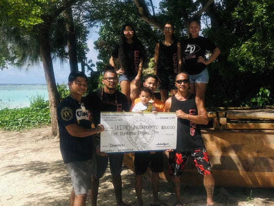 GUAM1 Beer continues their one penny for one can donation scheme, with a $500 check donation to Ulitao Inc. on Sept. 16 from distributor The Island King Imports. Pictured at Matapang Beach Park, from left: GUAM1 Beer spokesman Dwayne S. Blas, Jordan N. Richard, Tasi F. Acfalle, Ronald Hurao Acfalle Jr. holding young seafarer Halu'u Rai A. Acfalle, Mika Sanchez, Ronald Soriano Acfalle, and Maria M Acfalle.