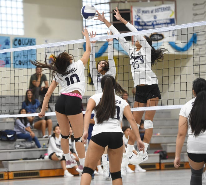 The Academy Cougars collide with the St. Paul Warriors for a IIAAG Girls Volleyball game at the Academy of Our Lady of Guam Gym in Hagåtña, Oct. 1, 2019.