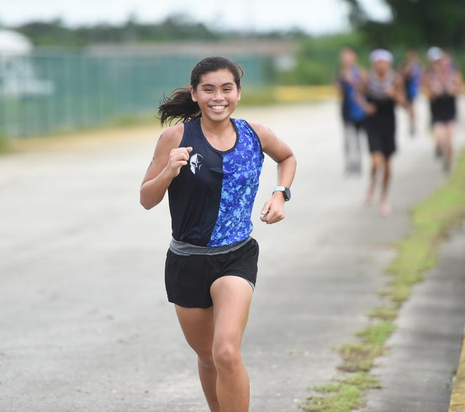 St. Paul's Shakeera Esma runs through the final lap of a IIAAG Cross-country meet at the Tiyan High School campus in Tiyan, Sept. 30, 2019.