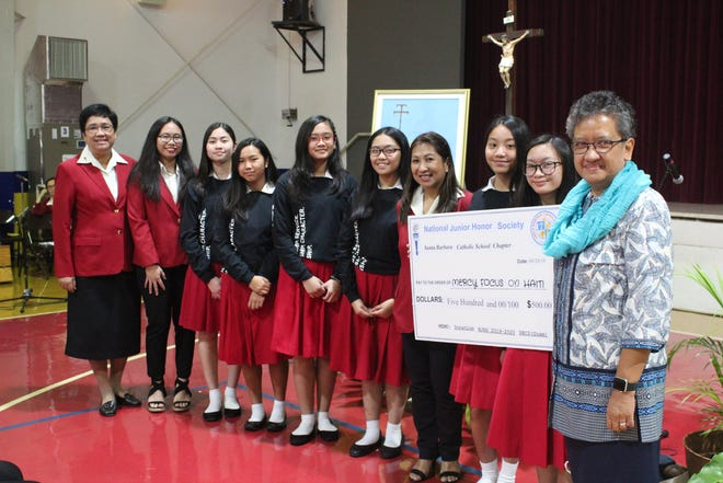 Members of the National Junior Honor Society of Santa Barbara Catholic School presented a $500 donation to Mercy Focus on Haiti on Sept. 20 as part of the school's celebration of mercy day and season of creation. Mercy Focus on Haiti is an initiative of the Sisters of Mercy of the Americas with a focus on responding to human needs in Haiti. Pictured with NJHS members are from left: SBCS Principal Sister Maria Rosario Gaite, RSM, Marianne Baysa NJHS co-advisor, Maricon Gozum, NJHS adivsor and Sister of Mercy Guam administrator Sister Marian Arroyo, RSM.