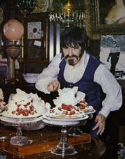 John Shambarger puts the finishing touches on his famous Mile High Strawberry Pie.